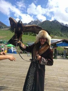 The author holding a falcon, wearing Kazakh robe and fur hat.